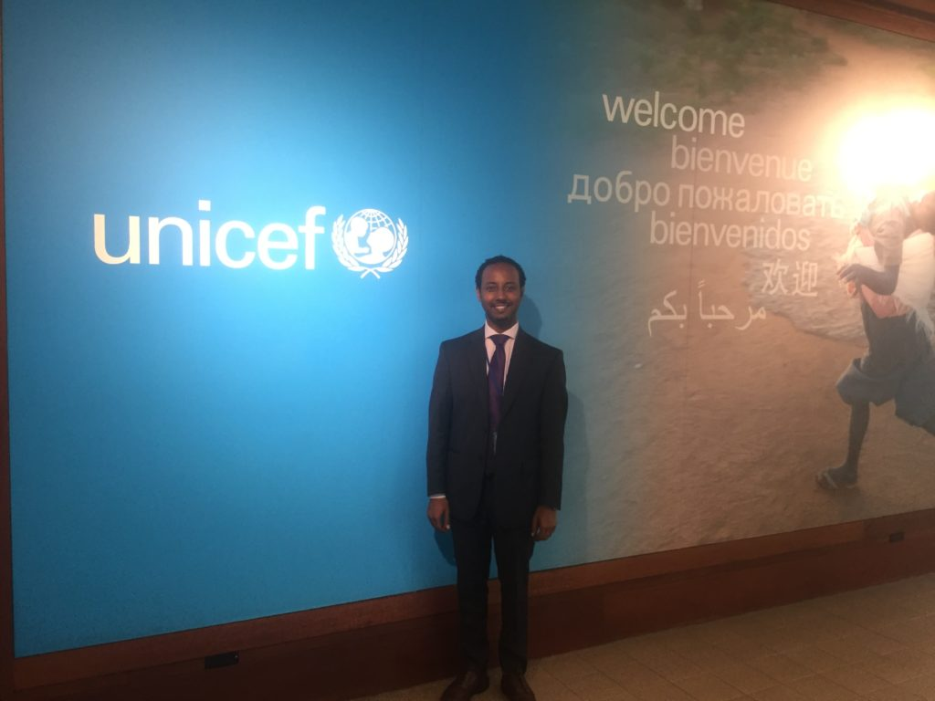 Nathan standing in the main lobby of UNICEF.