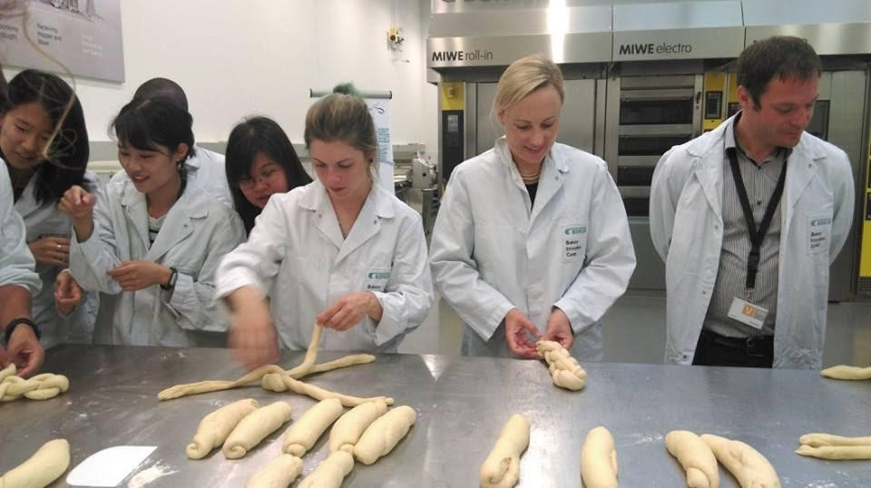 """Making traditional Swiss bread """"Zopf"""". I'm at the back observing my Swiss friend as she skillfully did it."""
