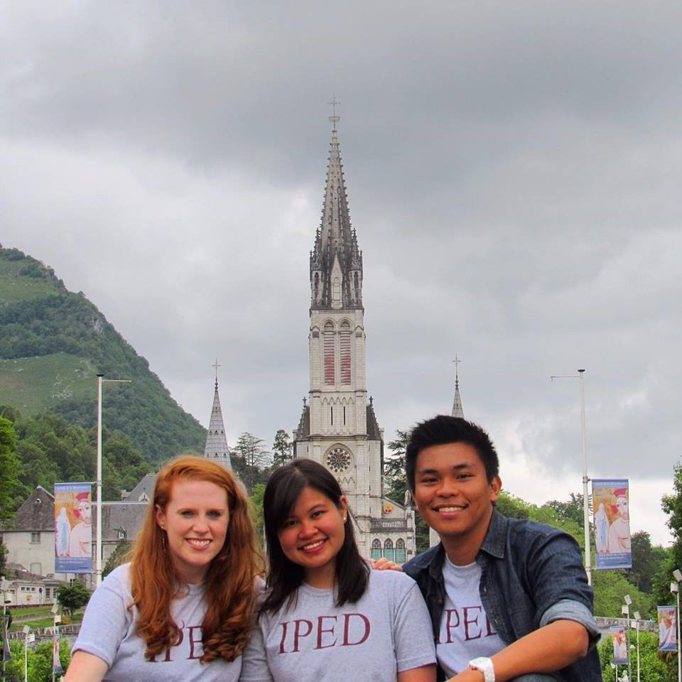 Katie, Jackie, and Armand showing their IPED pride at Lourdes, France