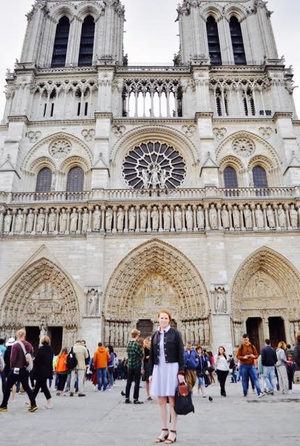 Katie in front of the Notre Dame Cathedral in Paris